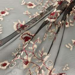 Tissu tulle souple noir avec des fleurs colorées