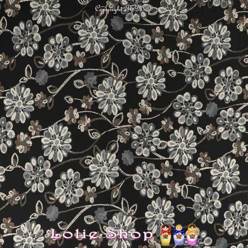 Jersey Crêpé Imprimé Fleurs et Floqué Gomme Fond Noir